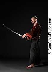 Young man in chinese costume with sword - Young man in...