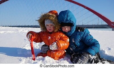 happy children playing in the Park on a Sunny winter day....