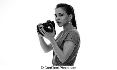 Woman photographer takes images with dslr camera black and...