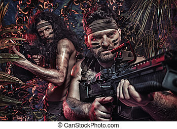 Colorful portrait of a two serious soldiers fighting in the jungle