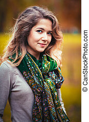 Portrait of a young girl with green neck scarf on the...