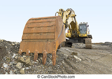 Excavator in rocky ambiance - dynamic shot of a tracked...