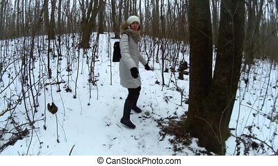 Following young female in winter forest POV go pro -...