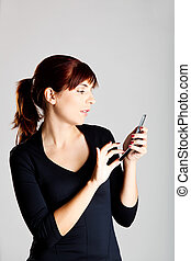 Sending a SMS - Portrait of a beautiful and attractive young...