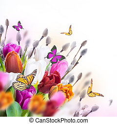 Multi-colored tulips with willow and butterflies. Easter...