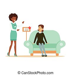 Store Seller Showing Blue Sofa To Woman, Smiling Shopper In Furniture Shop Shopping For House Decor Elements