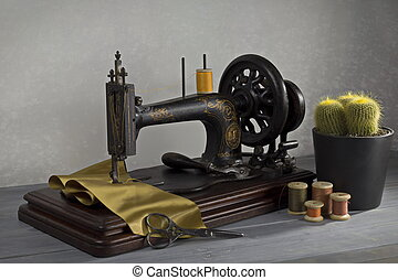 Vintage sewing machine with scissors and cactus