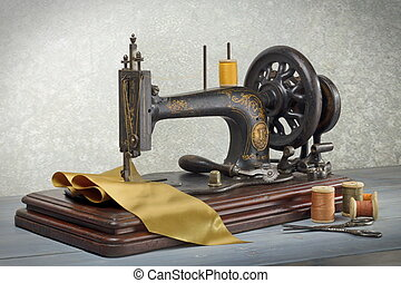 Vintage sewing machine with scissors and cloth