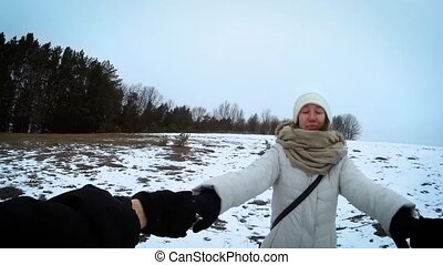 Circling with young female in winter plains go pro -...