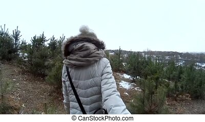 Following young female in winter plains POV go pro -...