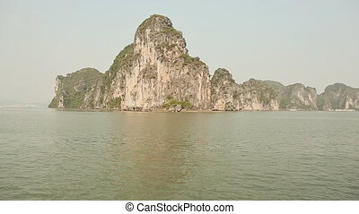 Rock islands near floating village in Halong Bay, Vietnam,...