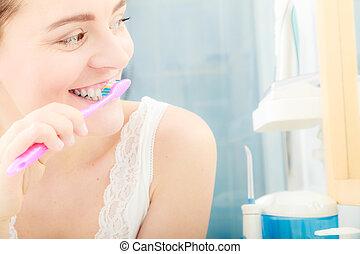 Woman brushing cleaning teeth. Oral hygiene.