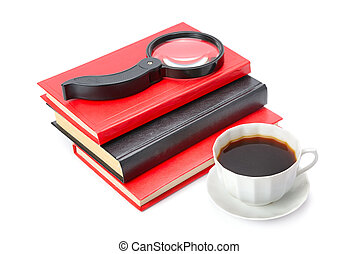 Books, a cup of coffee and magnifier isolated on white background