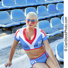 the sports blonde on steps of stadium
