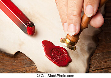 Hand with wax seal - Hand with ancient parchment or diploma...