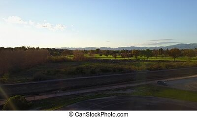 Stock aerial video of golf course at Sunset, Los Angeles...