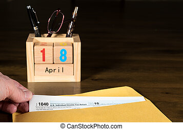 Tax day for 2016 returns is April 18, 2017 - Wooden letters...