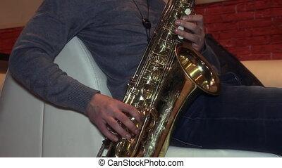 man playing a Golden saxophone - A man playing a Golden...