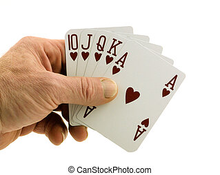 Winning hand  - Man's hand holding a royal flush in hearts.