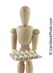 Manequin with pills - The wooden mannequin holds pills in a...