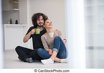 young couple in their new home - portrait of young happy...
