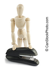 Manequin with stapler - Wooden manequin with a black stapler...