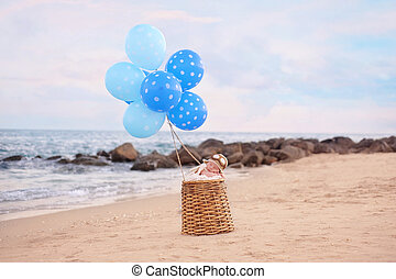 Baby Boy in a Hot Air Balloon - Two week old newborn baby...