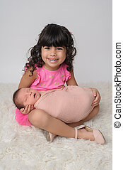 Toddler and Newborn Baby Sister Portrait - Portrait of a 3...