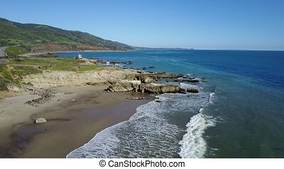 Aerial clip tilting up over a beach in Malibu, California....