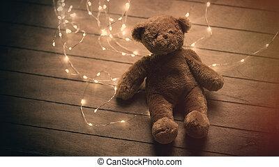 cute fluffy teddy bear and bright garland on the wonderful...