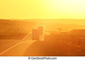 Semi trucks and sun glare along Trans Canada Highway