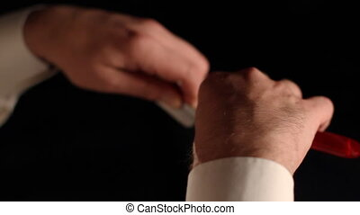 Straight Razor - Mans hands with open classic straight razor...