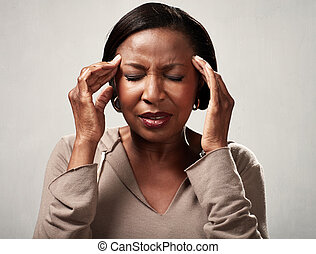 Headache - African american woman with headache migraine...