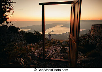 honeymoon couple travel mountains and sea view. Sunset in...