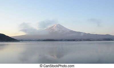 Timelapse mount fuji reflect on water in the morning at...