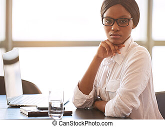Black businesswoman looking into camera with confident...