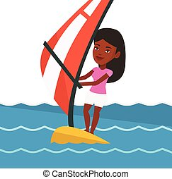 Young woman windsurfing in the sea. - African woman...