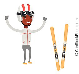 Cheerful skier standing with raised hands. - Smiling...