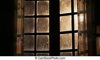 Old dirty and fabulous window opens outwards. Night time. -...