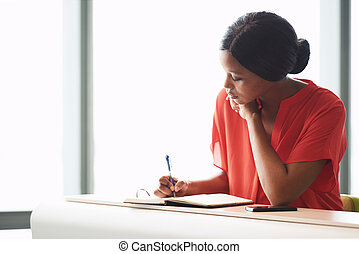 Concentrating young African American female entrepreneur...