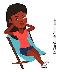Young woman sitting in folding chair. - Young...