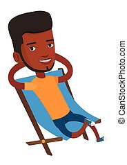 Young man sitting in folding chair. - Young african-american...