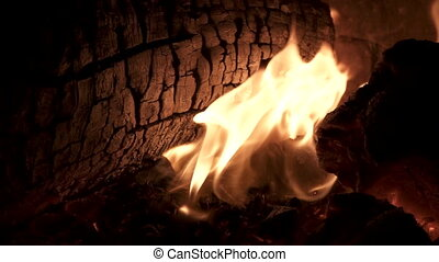 Fire and wood in super slow motion, closeup