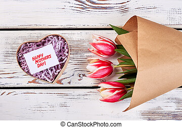 Heart-shaped box and flowers. Congratulation for dear...