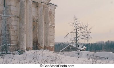 Old orthodox brick church in the country. Winter snowy day,...