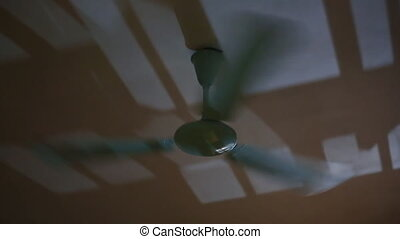 Running the fan in the room at night. Fast rotation. (Shot...