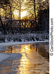 Sunset on the river in winter - Colorful evening with golden...