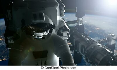 ISS. Astronaut and International Space Station Orbiting...