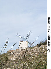 White old windmill on the hill near Consuegra (Castilla La...