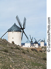White old windmills on the hill near Consuegra (Castilla La...